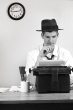 2692424 old style man reporter sitting at typewriter black and white Edit Your Content: 12 Things NOT to Miss